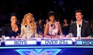 Doomed: Cowell with fellow X Factor USA judges Demi Lovato, Paulina Rubio and Kelly Rowland.