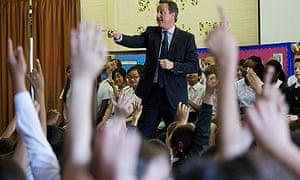 Britian's Prime Minister David Cameron Visits North London Schools