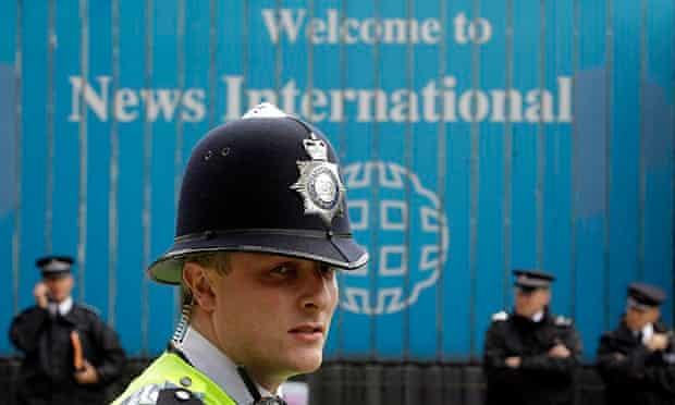 Police on duty outside News International