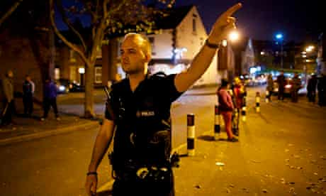 An emergency police patrol officer responds to a 999 call in Page Hall