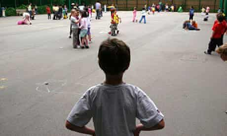 A child alone in a school playground, London Junior School.. Image shot 2004. Exact date unknown.