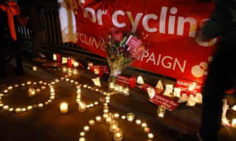 Members of the public at a shrine for the cyclist killed in Bow, east London