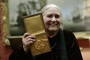 Doris Lessing obit: 2007: Doris Lessing shows her prize insignia of the Nobel Prize in Literatu