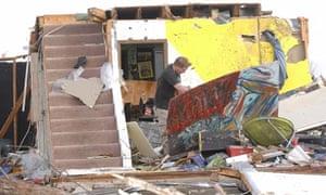 Washington homeowner moves debris