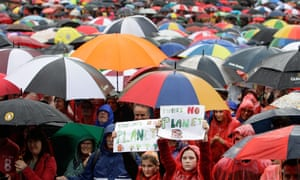 Sydneysiders gather in the rain during a climate change rally at Prince Alfred Park on 17 November 2013.
