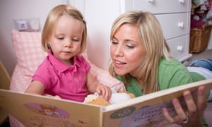 A mother reads to her daughter.