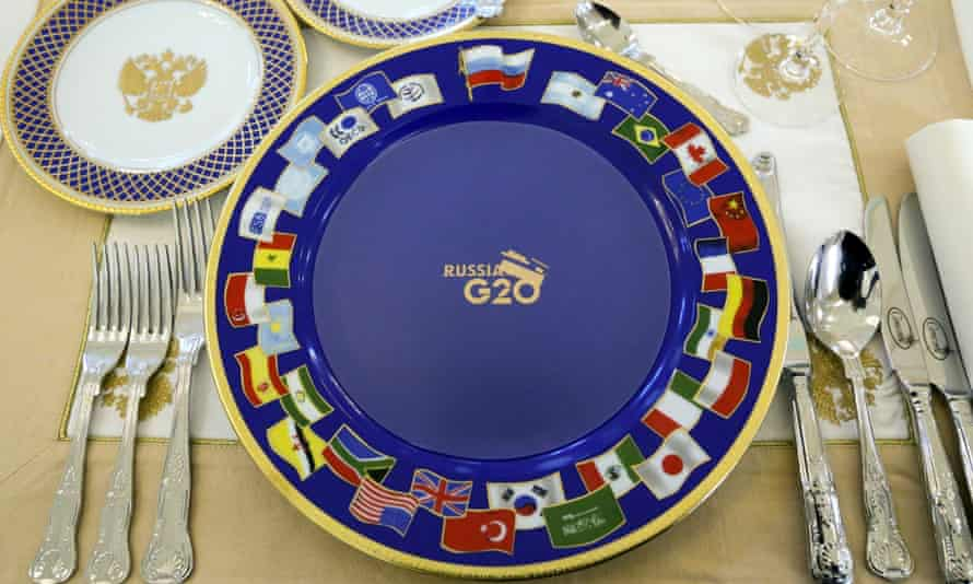 A dinner setting for G-20 leaders is placed on a table prior to a dinner at the Konstantin Palace in St. Petersburg, Russia on Thursday, Sept. 5, 2013. The threat of missiles over the Mediterranean is weighing on world leaders meeting on the shores of the Baltic this week, and eclipsing economic battles that usually dominate when the G-20 world economies meet. (AP Photo/Sergei Karpukhin, Pool) G20;G-20;Group of 20