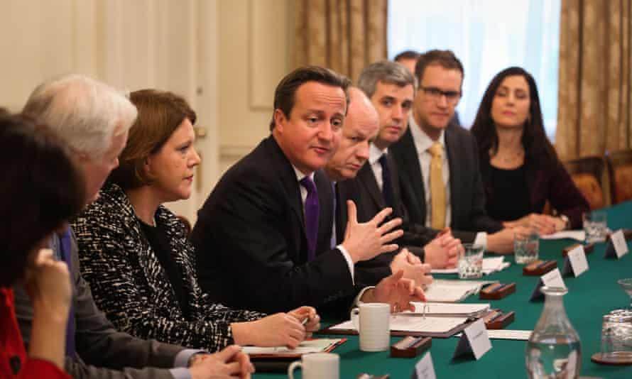 Secretary of State for Culture Media and Sport Maria Miller (third left) and Prime Minister David Cameron (centre) talk to members of leading search engines, internet service providers, the National Crime Agency and the NSPCC, during a child abuse summit in Downing Street, London. PRESS ASSOCIATION Photo. Picture date: Monday November 18, 2013.