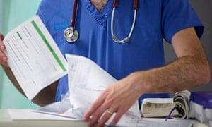 Doctor going through paperwork