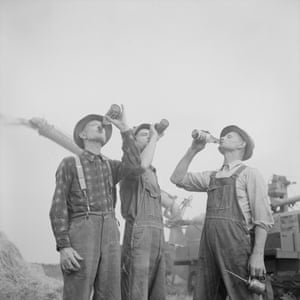 Three farmers break into a bottle of Old Milwaukee, a brand of dry lager, 1941