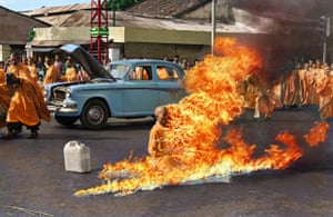 Colourised photo Quang Duc, a Buddhist monk, burns himself to death on a Saigon street to protest alleged persecution of Buddhists by the South Vietnamese government.