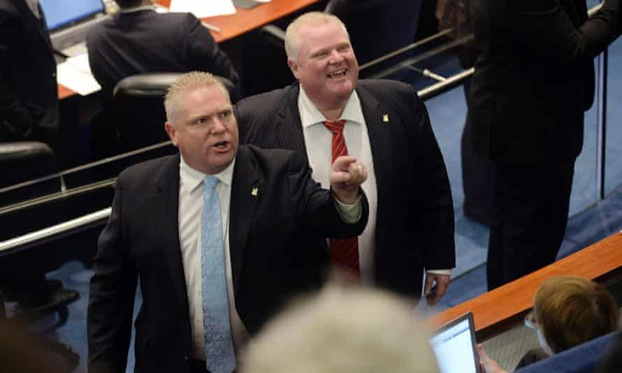 Rob Ford and his brother Doug, a Toronto council member, point to the gallery.