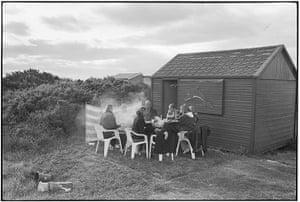Elliott Erwitt: BBQ outside with coats on