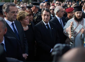 Greek Prime Minister Antonis Samaras (left) and Cyprus President Nicos Anastasiades (dent) attend the funeral of Former Cypriot President Glafcos Clerides on November 19, 2013 in Nicosia, Cyprus.