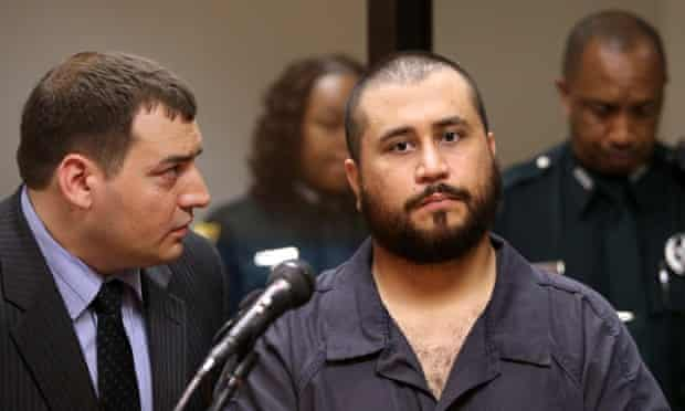 George Zimmerman listens to defense counsel Daniel Megaro at the hearing.