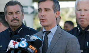 Los Angeles Police Chief Charlie Beck, left, joins Los Angeles Mayor Eric Garcetti, centre, during a news conference at Los Angeles International Airport.