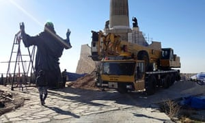 Workers prepare to install a statue of Jesus on Mount Sednaya, Syria