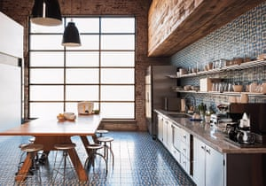 Homes - Remodelista: Kitchen and dining area with tiling and wooden table
