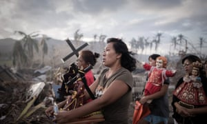 Survivors of Super Typhoon Haiyan march during a religious procession in Tolosa on the eastern Philippine island of Leyte.