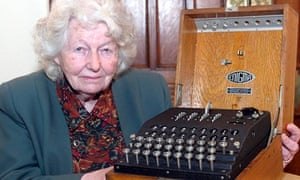 Mavis Batey at Bletchley Park, in Buckinghamshire, with an Enigma machine in 2004