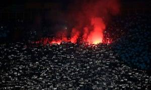 Napoli fans burn flares at the San Paolo Stadium