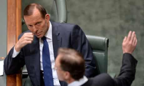 Tony Abbott listens to Environment minister Greg Hunt.