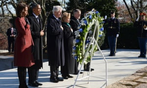 Barack and Michelle Obama, and Bill and Hillary Clinton lay a wreath at the gravesite for President John F Kennedy at Arlington National Cemetery on 20 November, 2013