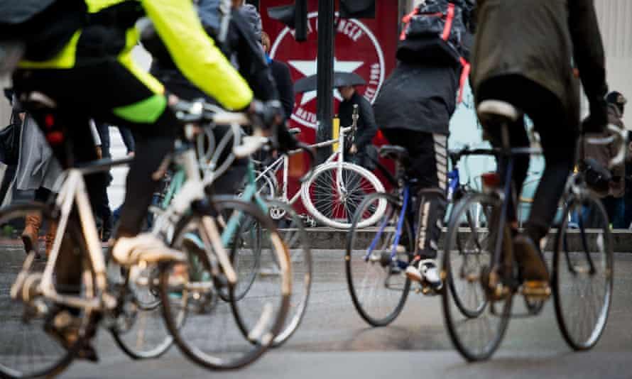 London cyclists pass a ghost bike