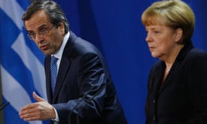 German chancellor Angela Merkel and Greece's prime minister Antonis Samaras at a news conference after their meeting in Berlin. Photo: Reuters/Thomas Peter
