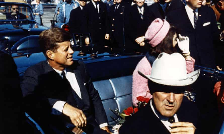 Texas Governor John Connally adjusts his tie as President John F Kennedy and his wife prepare for their tour of Dallas, Texas.