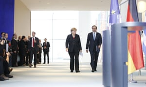 Greek prime minister Antonis Samaras and German chancellor Angela Merkel at the Federal Chancellery in Berlin. Photo: S. Struck/Demotix/Corbis