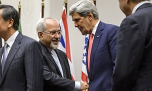 Iranian foreign minister Mohammad Javad Zarif shakes hands with US secretary of state John Kerry  after the deal