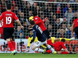 Wayne Rooney scores.