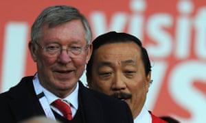 Sir Alex Ferguson joins Vincent Tan at the game.