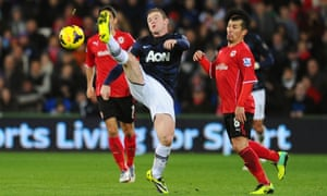 Wayne Rooney struggles to control the ball.