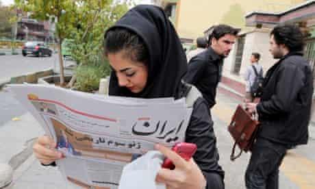 Iranian girl reading newspaper