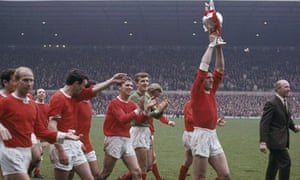 Bill Foulkes holding the First Division championship trophy aloft