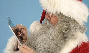 Father Christmas with a tablet