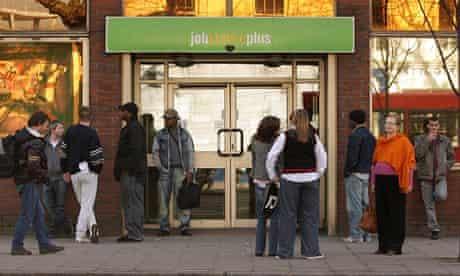 Job seekers queue at a Jobcentre