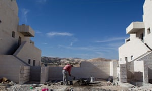 A man works at a new housing development in the Jewish West Bank settlement of Maaleh Adumim, near Jerusalem.