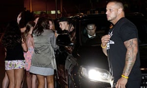 Justin Bieber poses for selfies with fans after arriving at Brisbane Airport