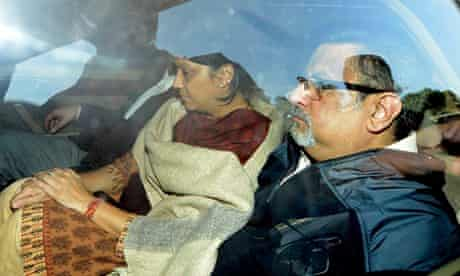 Nupur and Rajesh Talwar inside a car as Indian police drive them from court