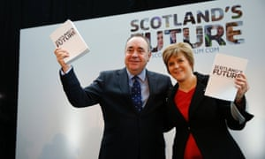 Scotland's first minister Alex Salmond  and deputy first minister Nicola Sturgeon hold copies of the independence white paper on 26 November 2013.
