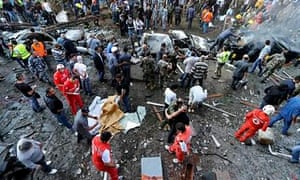 Emergency workers at the scene of the bomb blasts