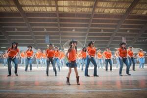 Big Picture - Spaghetti: women and children line-dancing wearing orange t-shirts