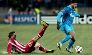 Hulk of FC Zenit St Petersburg evades Atlético's Emiliano Insua in their Champions League match.