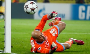 Napoli's goalkeeper Pepe Reina dives for the ball during their Champions League match against Borussia Dortmund.