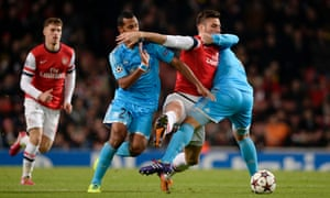 Arsenal's Olivier Giroud gets an arm in the face and gives an arm in the face, against Marseille in the Champions League.