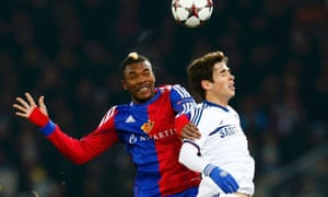 Basel's Serey Die challenges Chelsea's Oscar during their Champions League match at St Jakob-Park.