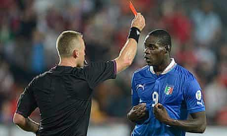 Mario Balotelli receives the red card during World Cup 2014 qualifying match Czech Republic vs Italy